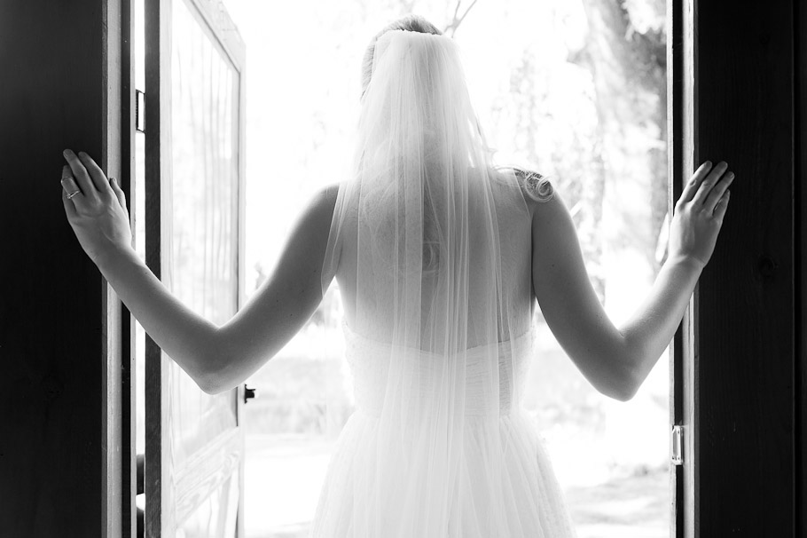 Wedding dress and veil shot from the back in the honeymoon cabin.