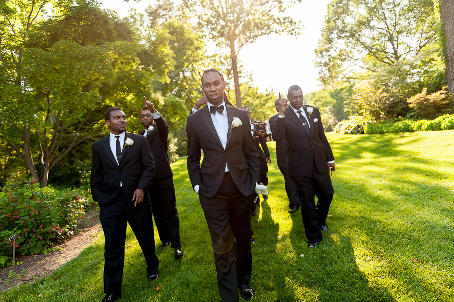 Groom and groomsmen walking to the ceremony location at Brookside Gardens' Fragance Garden