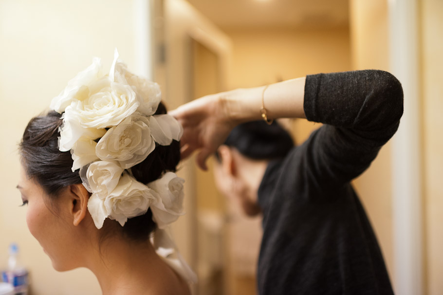 Bride getting hair done with some serious deco