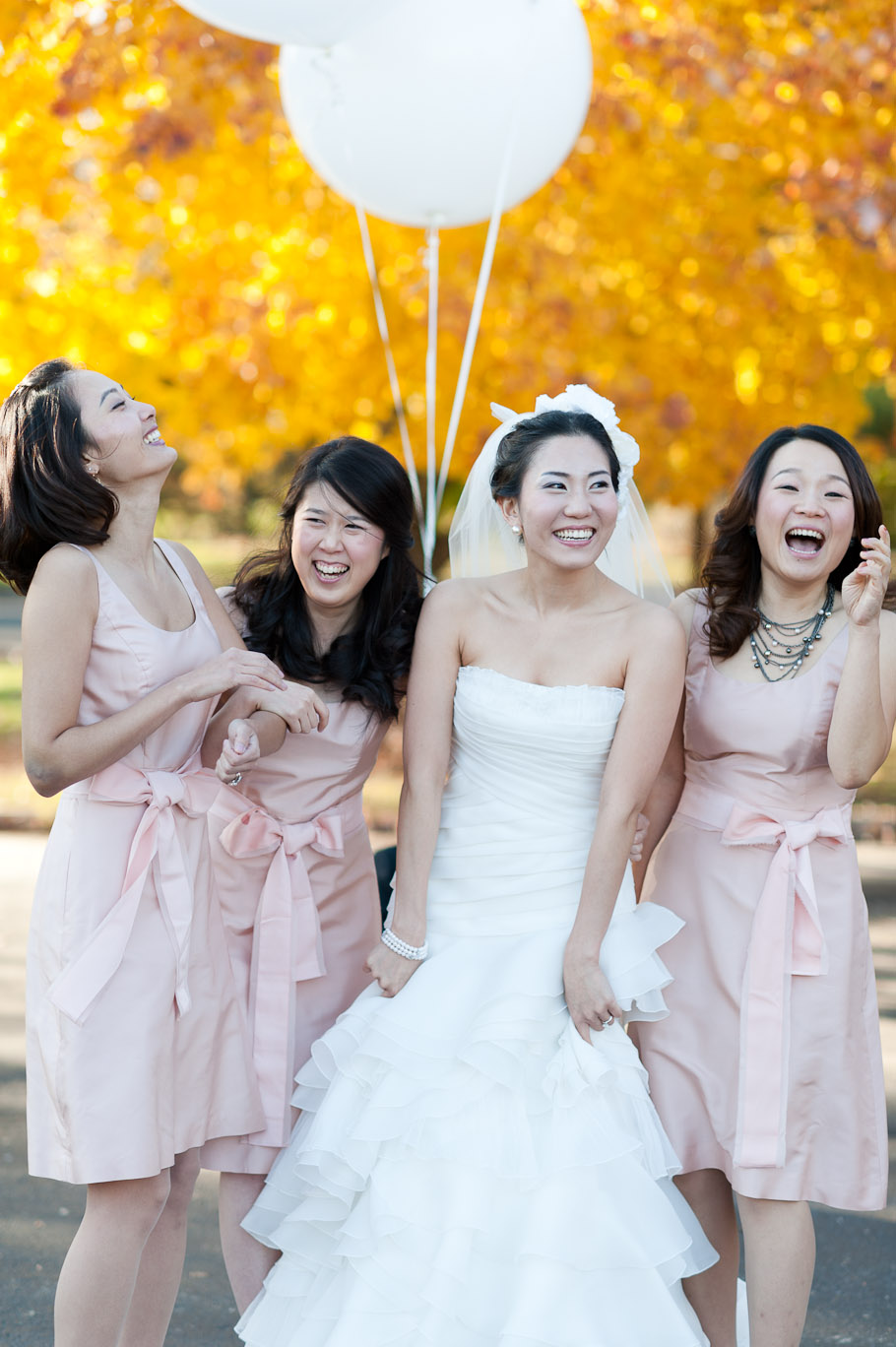 Bride and bridesmaids candidly enjoying themselves