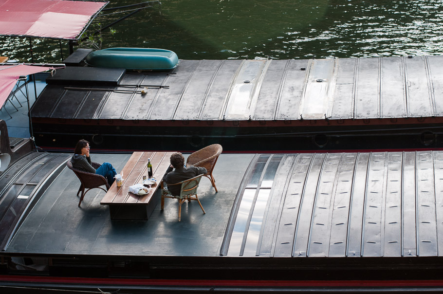 Laid back Parisian life having bread and wine on floating homes