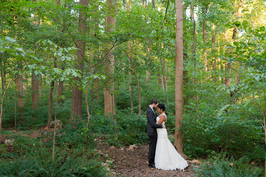 The newly weds getting cozy in the woods